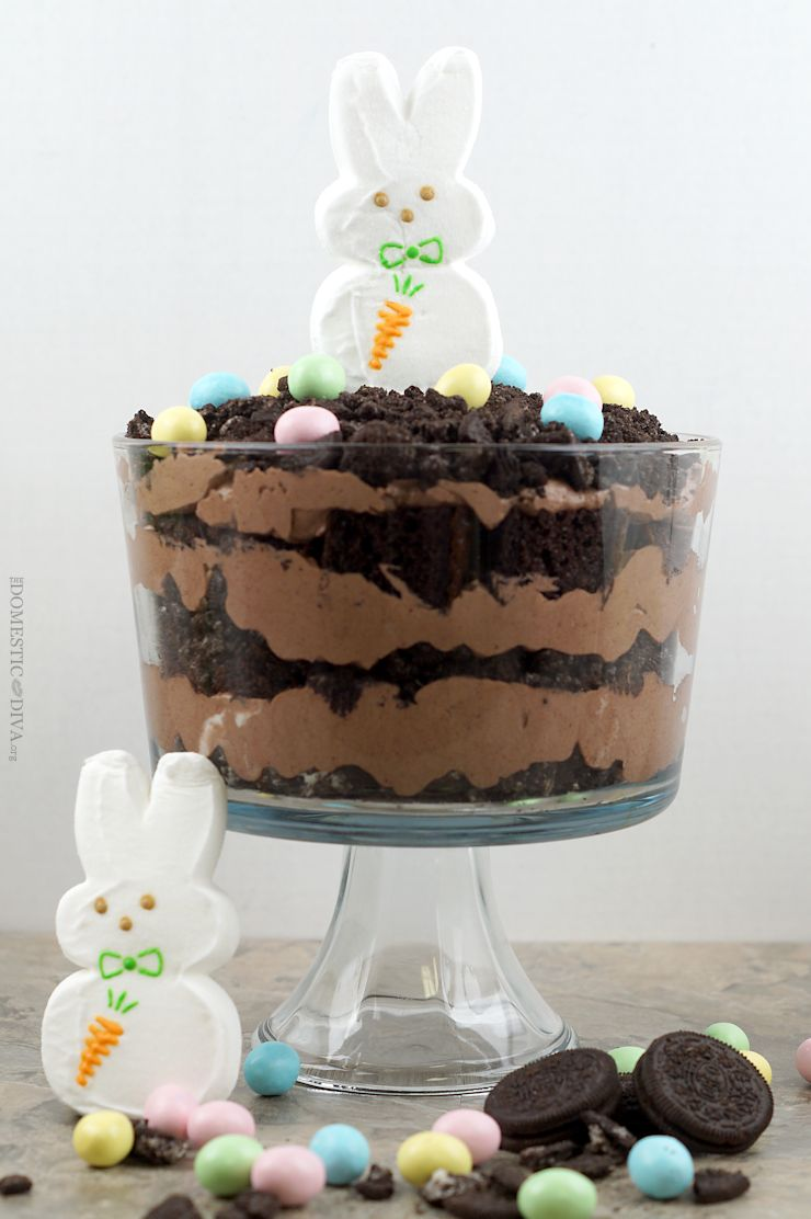 Easter Bunny Dirt Cake Trifle Recipe: Rich chocolatey cake trifle with decadent layers of chocolate pudding and crushed oreos. Top this trifle with Easter themed edible decorations like a marshmallow bunny and milk chocolate candy coated eggs and you have a dessert everyone will be talking about.
